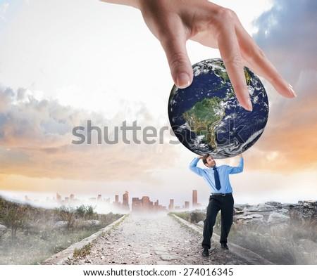 Hand showing against stony path leading to misty city horizon