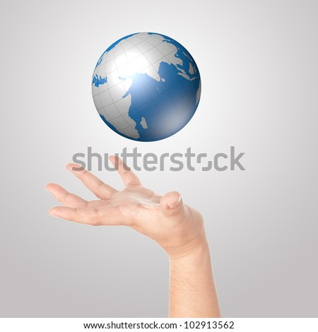 Hand showing digital globe - stock photo