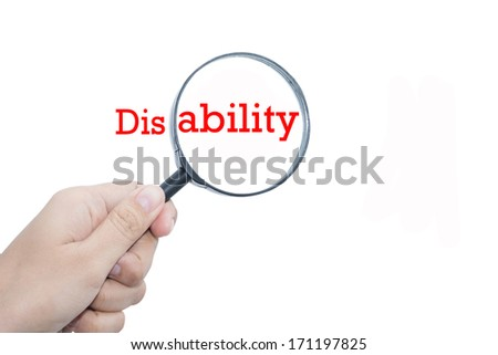 Hand Showing disability Word Through Magnifying Glass