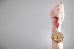 Hand showing medal. Sport, Winner, Success