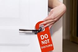 Hand sign do not disturb put on the room doors