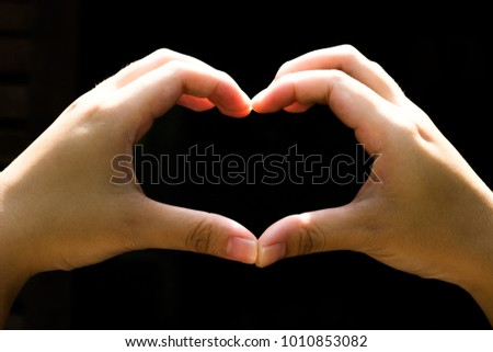 Hand sign language for Valentine's Day with a beautiful heart-shaped hand. #1010853082