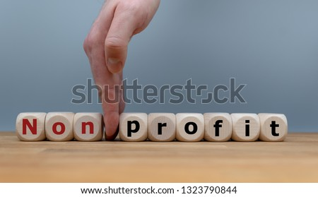 "Hand splits the word ""Nonprofit"" to ""Profit""."