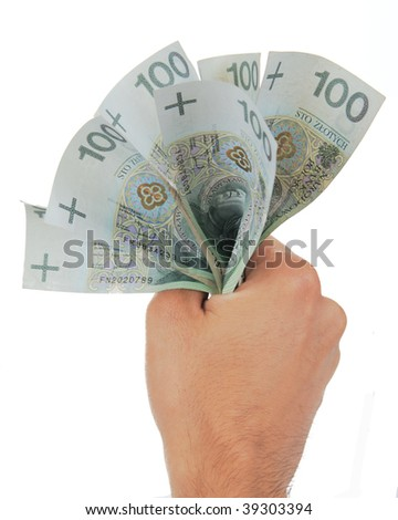 Hand squeezing bunch of banknotes against white background