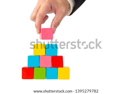 hand stacking a color wooden block #1395279782