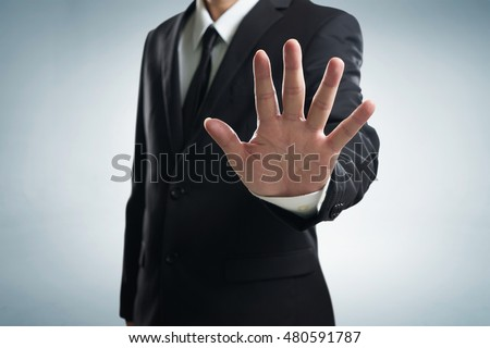 Hand stop shown by businessman. Stockfoto ©