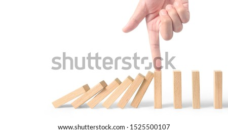 Hand stopping the Domino effect stopped by unique, Business Ideas #1525500107