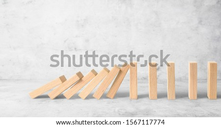 Hand stopping the Domino effect stopped by unique, Business Ideas #1567117774