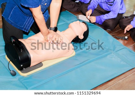 hand student Heart pump with medical dummy on CPR, in emergency refresher training to assist of physician #1151329694