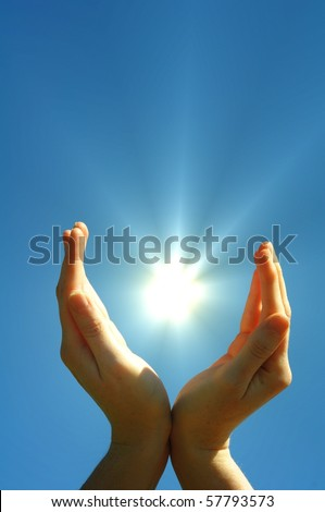 hand sun and blue sky with copyspace showing freedom or solar power concept - stock photo