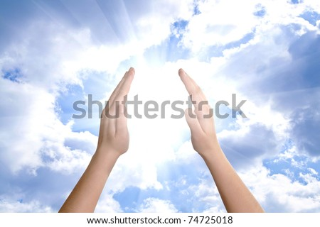 hand sun and clouds with copyspace showing freedom or solar power concept