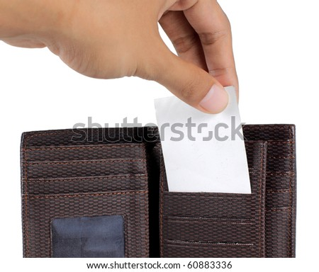 hand taking card inside brown wallet