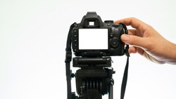 Hand taking pictures with a DSLR camera. mockup camera view
