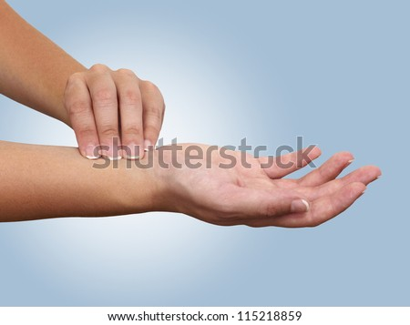 Hand taking radial artery pulse. Isolation on a white background