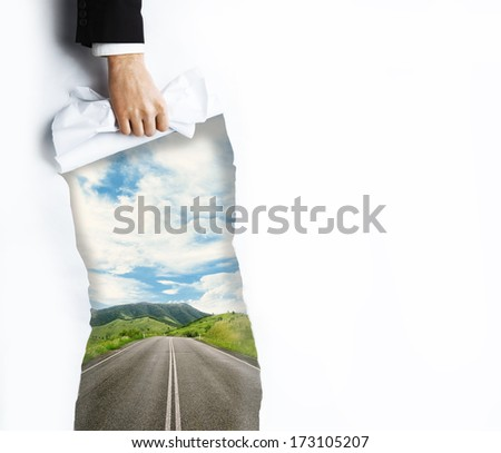 Hand Tears White Page To Road