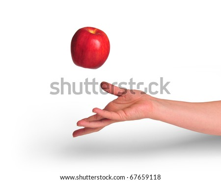 hand throwing apple - stock photo