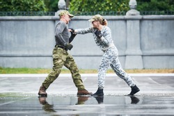 hand to hand combat between military instructor with female trainee