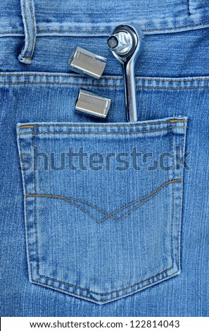 hand tool on jean background