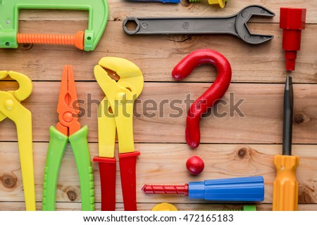 hand tools collection with question mark on wooden background business solution concept
