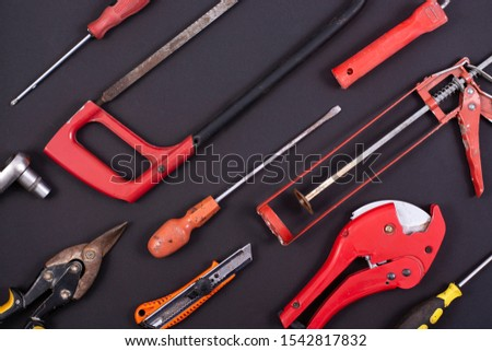 Hand tools on a black background.