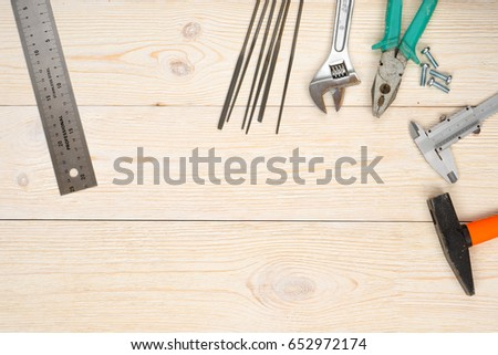 hand tools on wooden planks #652972174