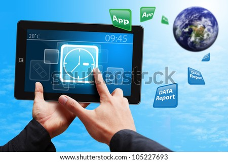 Hand touch on Clock icon on touch pad : Elements of this image furnished by NASA