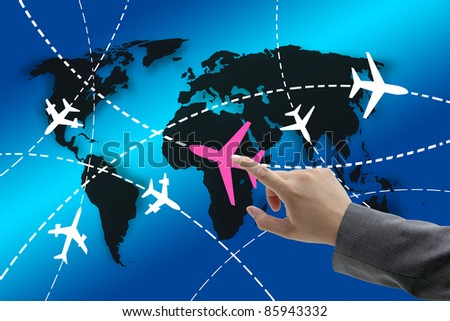 hand touch on planes with routes around the world for business travel concept
