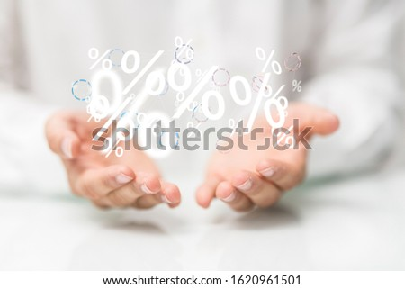 hand touches virtual percent icon