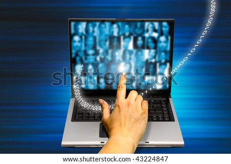 hand touching a laptop screen with people photos, concept for social network
