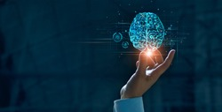 Hand touching brain of AI, Symbolic, Machine learning, artificial intelligence of futuristic technology. AI network of brain on business analysis, innovative and business growth development.