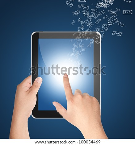 Hand touching tablet PC with incoming mails for internet, social connectivity