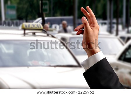 hand trying to pick a taxi