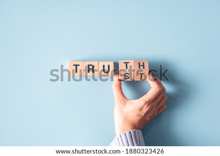 Hand turned wood cube and changes the word 'Trust' to 'Truth'. Сток-фото ©