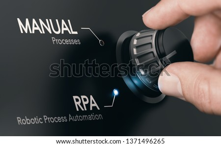 Hand turning a knob over dark grey background and selecting RPA (Robotic Process Automation) mode. Artificial Intelligence concept. Composite image between a hand photography and a 3D background. Stock photo ©