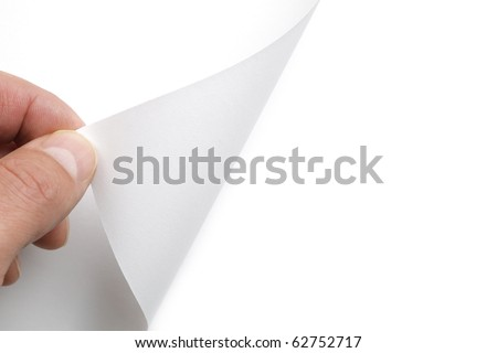 Hand turning over page to reveal blank copy space for message