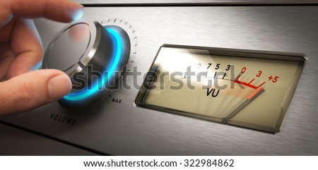 Hand turning the volume knob of an amplifier up to the maximum, Concept image for noisy environment or hearing problems #322984862