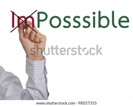 "Hand turning the word ""Impossible"" into ""Possible"""
