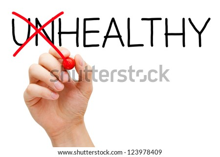 Hand turning the word Unhealthy into Healthy with red marker isolated on white