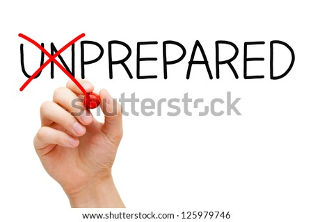 Hand turning the word Unprepared into Prepared with red marker isolated on white.