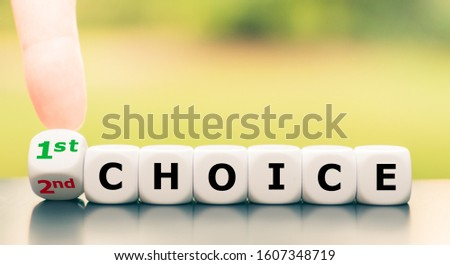 """Hand turns a dice and changes the expression """"2nd choice"""" to """"1st choice"""", or vice versa."""