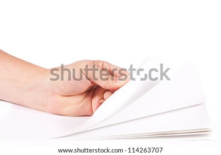 Hand turns blank paper