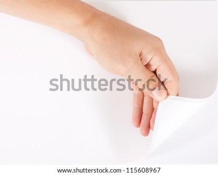 Hand turns blank paper