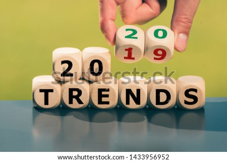 "Hand turns cube and changes the expression ""2019 Trends"" to ""2020 Trends"". #1433956952"