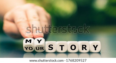 Hand turns dice and changes the expression 'your story' to 'my story'. Stock foto ©