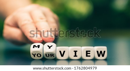 Hand turns dice and changes the expression 'your view' to 'my view'. Stockfoto ©