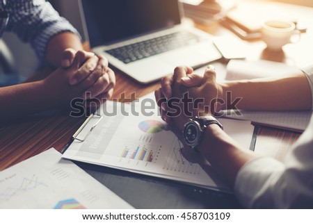 Hand, two men on a desk. Negotiating business. #458703109