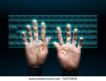 hand typing in on a virtual keyboard interface