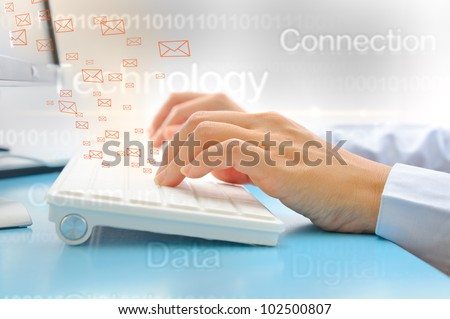 Hand typing on computer keyboard