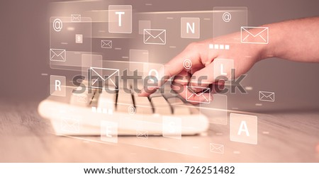 Hand typing on keyboard with digital tech icons and symbols #726251482