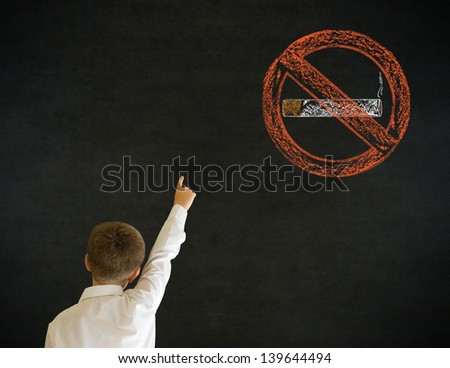 Hand up answer boy dressed up as business man with no smoking chalk sign on blackboard background
